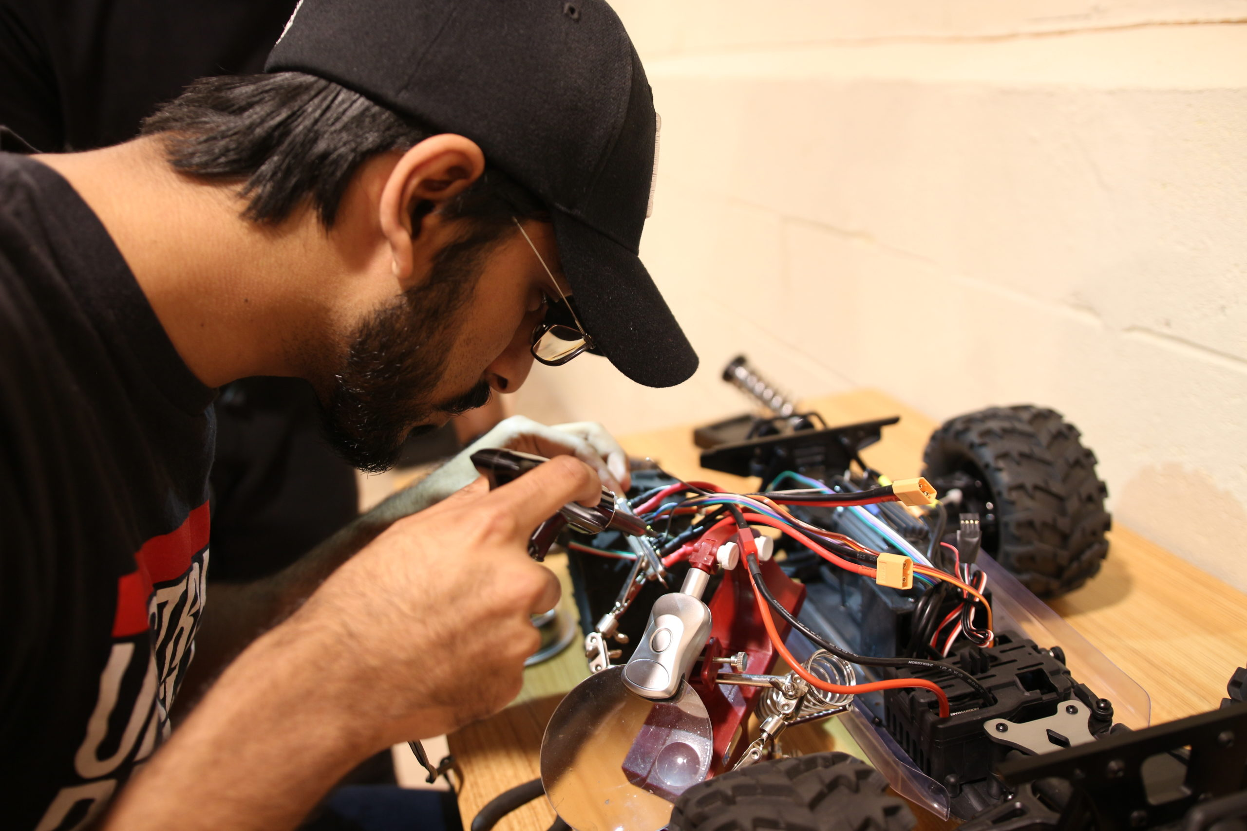 CTO of Aersys repairing Kiwibot, a delivery rover